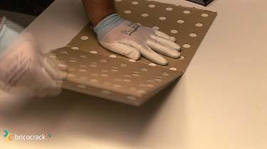 6. Instalar placas de vinilo para paredes